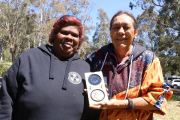 Vicky and Aunty Sue holding Noble Peace Prize